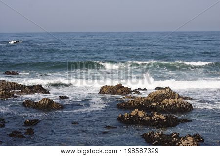 This is an image of the incoming tide at Asilomar State Beach at Pacific Grove, California.