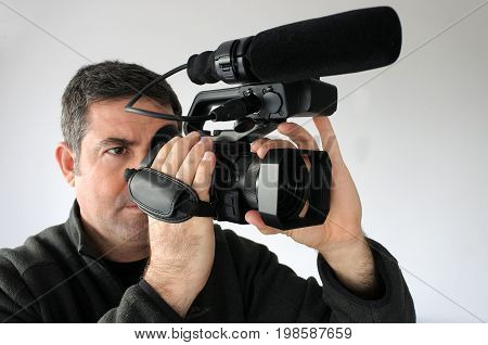 Professional Cameraman Filming Footage With Video Camera