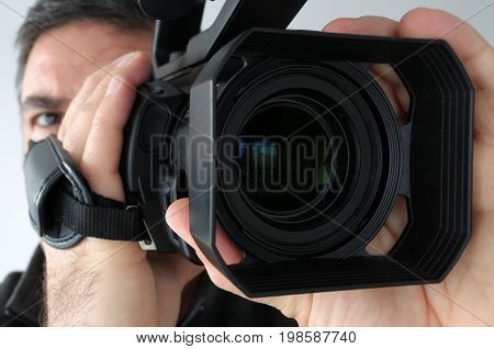Close Up Video Camera Lens With Of Cameraman  Filming