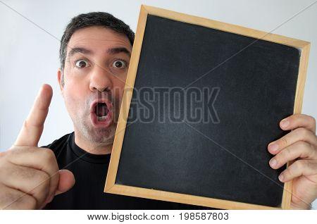 Man Holds Empty Blackboard Shouting