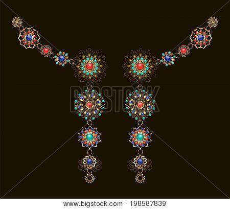 Symmetrical ethnic decoration with lapis lazuli jasper and turquoise on a dark background. Jewelery in boho style.