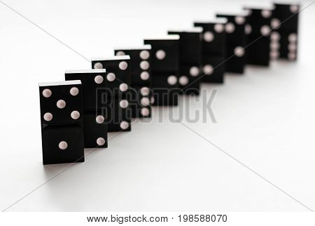 Domino Standing On Edge. Isolated On A White Background. Closeup