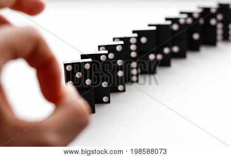 Domino Knocks The Flick Of A Finger. Dominoes Isolated On A White Background