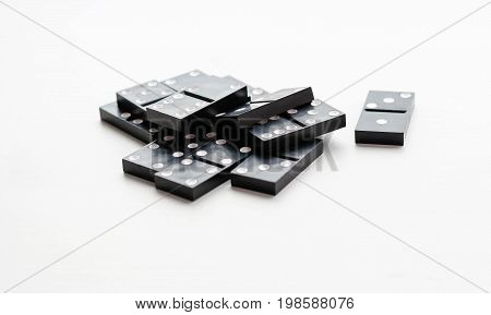 Domino Sits In A Pile. Isolated On A White Background. Closeup