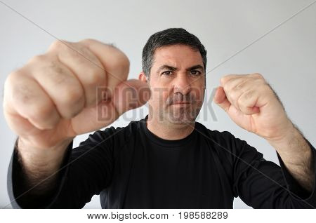 Aggressive Man Holds Fists