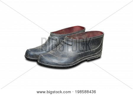 Dirty Black Rubber Galoshes. Isolated On A White Background. Closeup