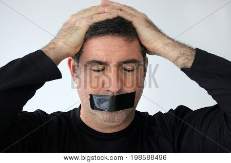 Man With Closed Eyes And Mouth Covered With Masking Tape