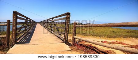 Bridge Along The Peaceful And Tranquil Marsh Of Bolsa Chica Wetlands