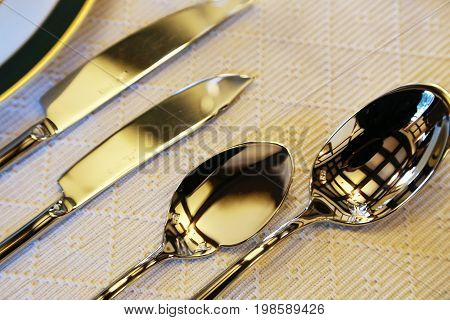 Spectacle of shiny metal tableware on table