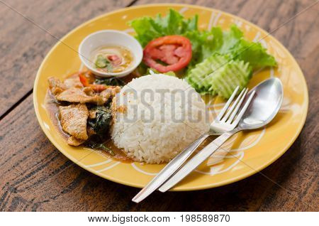 Thai food,spicy fried pork with pepper and jasmine rice in the restaurant