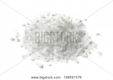 Heap of salt flakes on white background