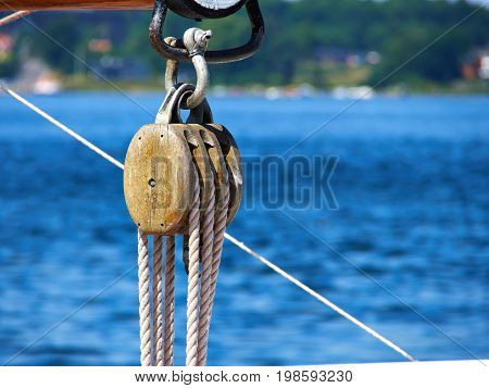 Pulley for sails and ropes made from wood on an old sail boat