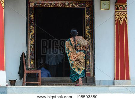 Indian Woman Coming To The Bhutanese Temple