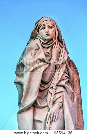 ROME, ITALY - JANUARY 18, 2017 Saint Catherine Siena Statue Castel Sant Angelo Rome Italy. 14th Century Saint considered co-saint of Italy with Saint Francis Christian mystic. Statue created 1961 by Francesco Messina.