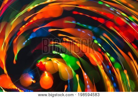 Abstract picture of bright colored dynamic lights on a dark background