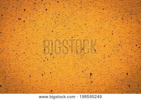 Background of a painted yellow iron metal sheet iron texture