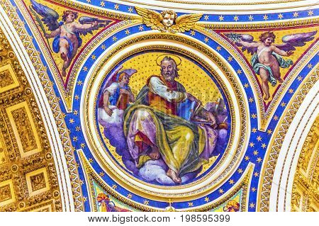 ROME, ITALY - JANUARY 18, 2017 Saint Matthew Gospel Writer Evangelist Mosaic Angels Saint Peter's Basilica Vatican Rome Italy. Mosaic right below Michaelangelo's Dome Created in 1600s over altar and St. Peter's tomb