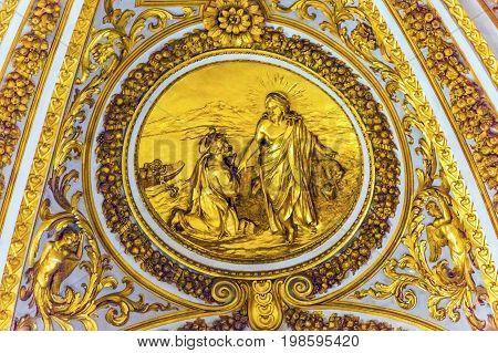 ROME, ITALY - JANUARY 18, 2017 Golden Christ Peter Above Altar below Dome Saint Peter's Basilica Vatican Rome Italy. Dome built in 1600s over altar and St. Peter's tomb