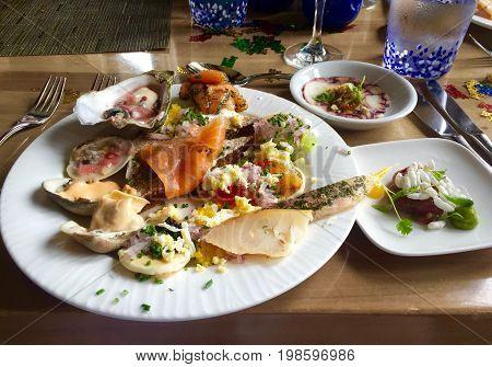Artistic Seafood Platter: Salmon, Caviar and Shellfish.