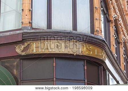 LONDON UNITED KINGDOM - JUNE 23 2017: Harrods luxury department store on Brompton Road signboard. 7-storey building built in 1905 has 330 departments covering 90000 m2 of retail space