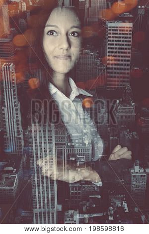 Portrait of woman reflecting in window against cityscape with skyscrapers