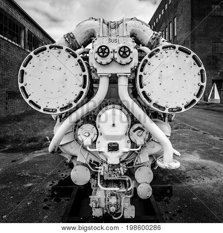PEENEMUENDE GERMANY - JULY 18 2017: Old ship diesel engine. Black and white. Territory of the Army Research Center. During the World War II the area was highly involved in the development and production of the V-2 rocket.