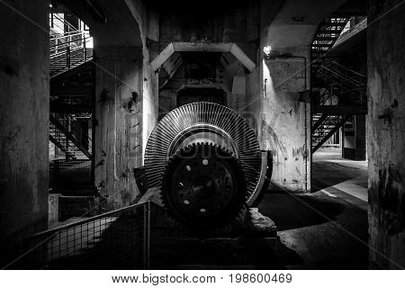 PEENEMUENDE GERMANY - JULY 18 2017: Abandoned rocket production workshops. Black and white. Territory of the Army Research Center. During the World War II the area was highly involved in the development and production of the V-2 rocket.