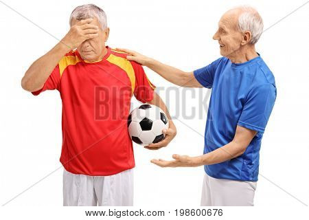 Elderly soccer player consoling another player isolated on white background