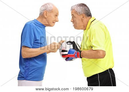 Elderly soccer player and a goalkeeper having an argument isolated on white background