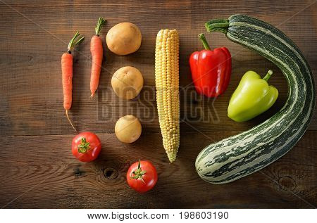 Healthy food background . studio photography of different vegetables on old wooden table