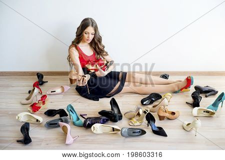 Girl can't decide what shoes to wear