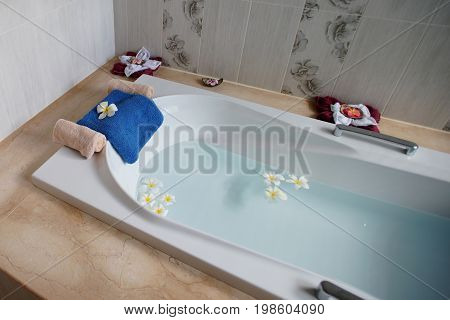 Top View Of Bathtub With Towel And Frangipani Flower