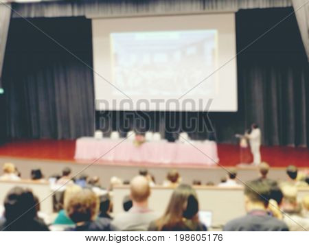 Blurred Image Of Business Conference And Presentation. People Meeting Conference Seminar, Audience A