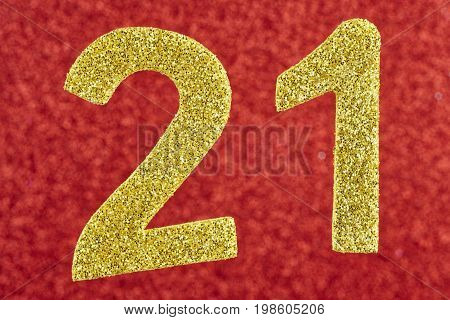 Number twenty-one golden over a red background. Anniversary. Horizontal