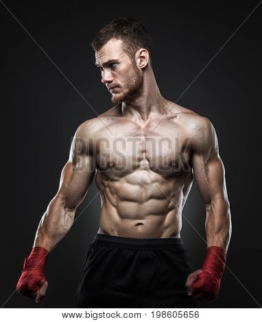MMA fighter got ready for the fight. Dark background.