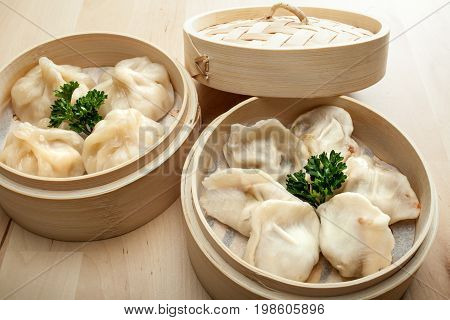 Chinese Dumpling In A Bamboo Steamer Box