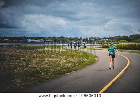 Lonely Woman Leading A Group Of 10K Runners