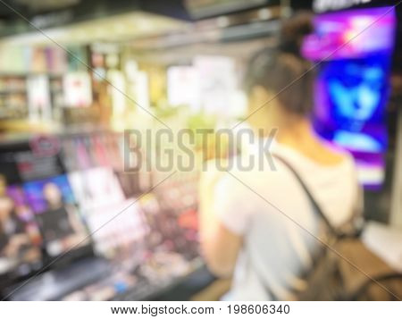 Blurred Image Of Shopping Mall And People Or Businesswoman In Beauty Shop.