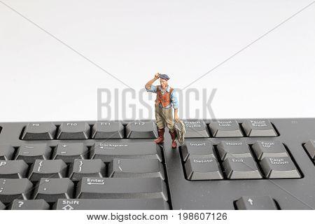 Min Figure Work On The Computer Key Board
