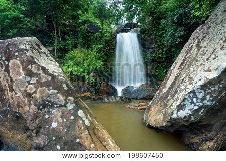 Beautiful waterfall in green forest in jungle Thailand