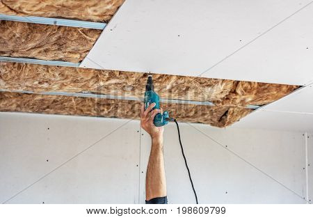 Fixing plasterboard sheets to the frame. plasterboard