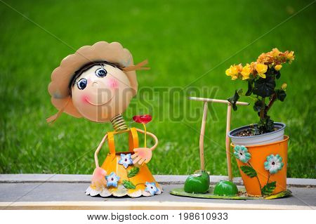 A puppet with happy face in the garden