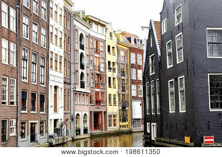 Scenic view of colorful buildings and canal in Amsterdam Holland Europe