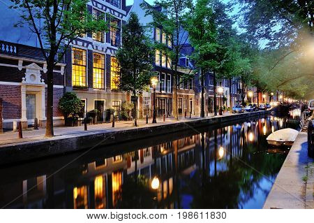 Canal of Amsterdam scenic view at night Netherlands Europe