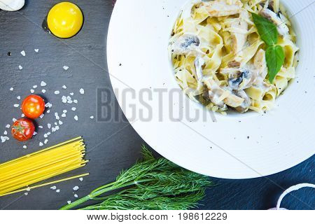 Pasta With Mushrooms On A Black Slate Background