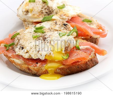 Traditional Norwegian breakfast. Sandwich eggs with salted fish and onions.