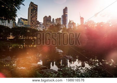 Dawn With Sunset In Central Park With Skyscrappers Inbackground