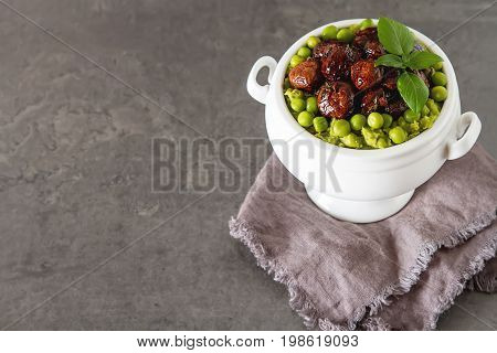 Pea Puree With Mushrooms In A White Ceramic Bowl. Delicious Vege