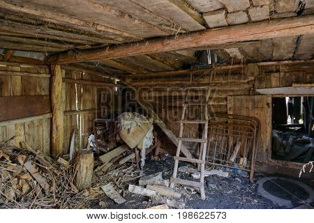 A bunch of objects and debris in an old wooden house