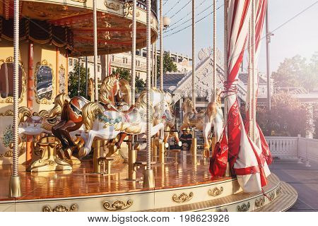 Outdoor flying horse carousel in the the city